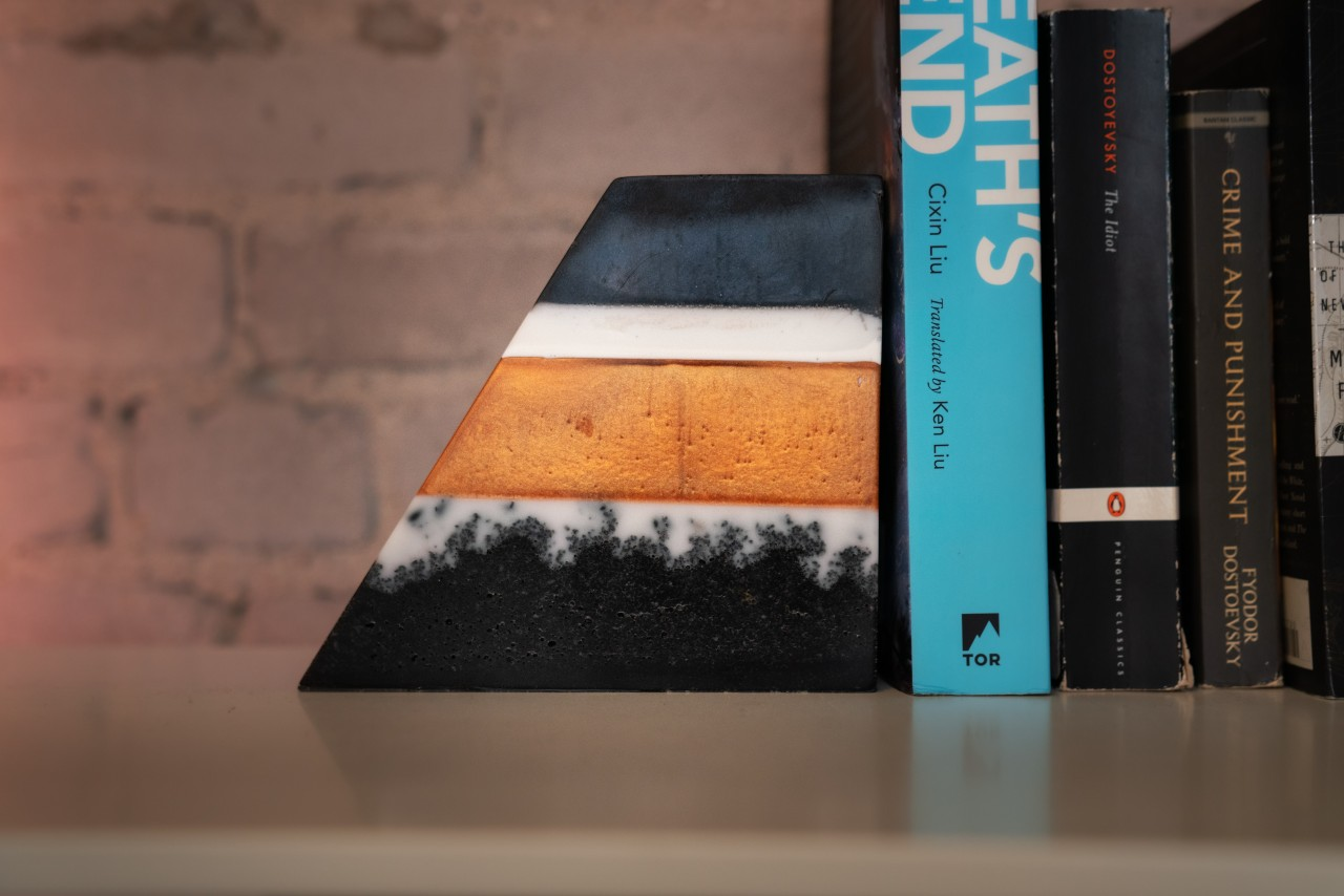 Custom Bookends made with stones and layers of ProPour Epoxy from Pro Marine Supplies.
